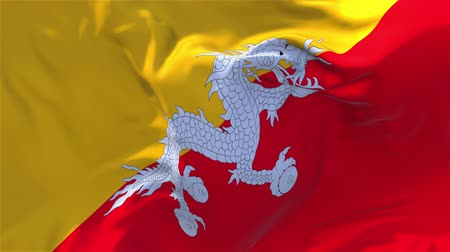 bhutan : Bhutan Flag Waving in Wind Slow Motion Animation . 4K Realistic Fabric Texture Flag Smooth Blowing on a windy day Continuous Seamless Loop Background. Stock Footage