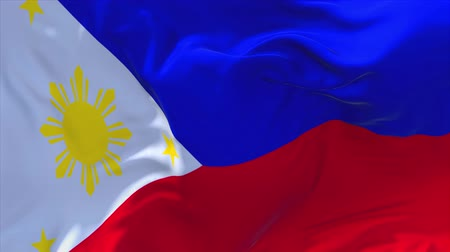 filipíny : Philippines Flag Waving in Wind Slow Motion Animation . 4K Realistic Fabric Texture Flag Smooth Blowing on a windy day Continuous Seamless Loop Background.