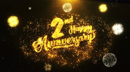 jubileu : 2nd Happy Anniversary Text Greeting and Wishes card Made from Glitter Particles From Golden Firework display on Black Night Motion Background. for celebration, party, greeting card, invitation card.