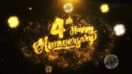 th : 4th Happy Anniversary Text Greeting and Wishes card Made from Glitter Particles From Golden Firework display on Black Night Motion Background. for celebration, party, greeting card, invitation card. Stock Footage