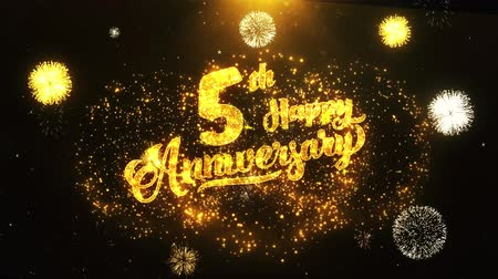 jubileu : 5th Happy Anniversary Text Greeting and Wishes card Made from Glitter Particles From Golden Firework display on Black Night Motion Background. for celebration, party, greeting card, invitation card. Vídeos