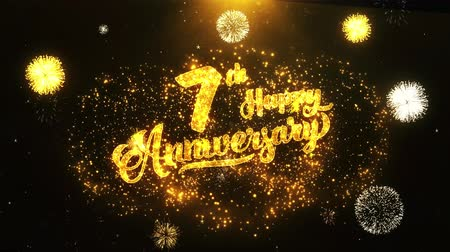 jubileu : 7th Happy Anniversary Text Greeting and Wishes card Made from Glitter Particles From Golden Firework display on Black Night Motion Background. for celebration, party, greeting card, invitation card. Vídeos