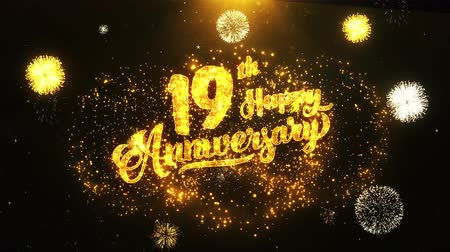 jubileu : 19th Happy Anniversary Text Greeting and Wishes card Made from Glitter Particles From Golden Firework display on Black Night Motion Background. for celebration, party, greeting card, invitation card.
