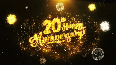 jubileu : 20th Happy Anniversary Text Greeting and Wishes card Made from Glitter Particles From Golden Firework display on Black Night Motion Background. for celebration, party, greeting card, invitation card.