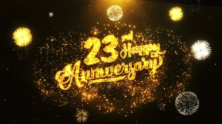 jubileu : 23rd Happy Anniversary Text Greeting and Wishes card Made from Glitter Particles From Golden Firework display on Black Night Motion Background. for celebration, party, greeting card, invitation card.