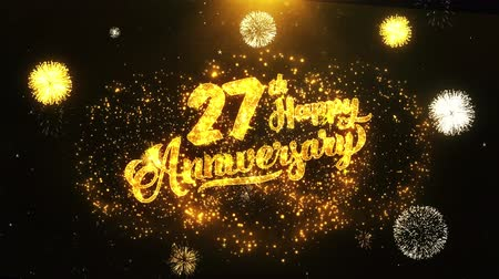 jubileu : 27th Happy Anniversary Text Greeting and Wishes card Made from Glitter Particles From Golden Firework display on Black Night Motion Background. for celebration, party, greeting card, invitation card.