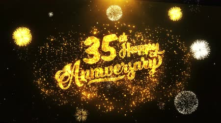 jubileu : 35th Happy Anniversary Text Greeting and Wishes card Made from Glitter Particles From Golden Firework display on Black Night Motion Background. for celebration, party, greeting card, invitation card. Stock Footage
