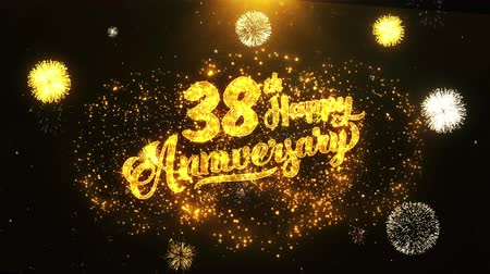 th : 38th Happy Anniversary Text Greeting and Wishes card Made from Glitter Particles From Golden Firework display on Black Night Motion Background. for celebration, party, greeting card, invitation card. Stock Footage