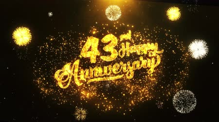 jubileu : 43rd Happy Anniversary Text Greeting and Wishes card Made from Glitter Particles From Golden Firework display on Black Night Motion Background. for celebration, party, greeting card, invitation card. Stock Footage