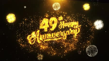 jubileu : 49th Happy Anniversary Text Greeting and Wishes card Made from Glitter Particles From Golden Firework display on Black Night Motion Background. for celebration, party, greeting card, invitation card.