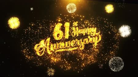 jubileu : 61st Happy Anniversary Text Greeting and Wishes card Made from Glitter Particles From Golden Firework display on Black Night Motion Background. for celebration, party, greeting card, invitation card. Stock Footage