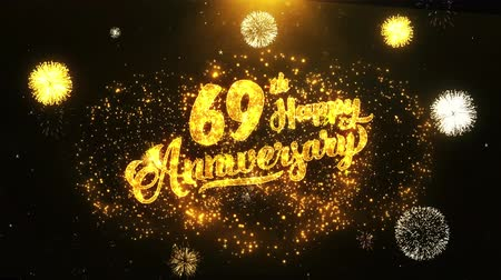 jubileu : 69th Happy Anniversary Text Greeting and Wishes card Made from Glitter Particles From Golden Firework display on Black Night Motion Background. for celebration, party, greeting card, invitation card.
