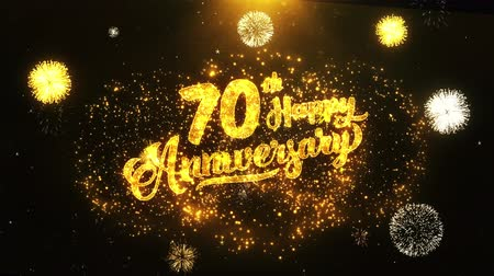 jubileu : 70th Happy Anniversary Text Greeting and Wishes card Made from Glitter Particles From Golden Firework display on Black Night Motion Background. for celebration, party, greeting card, invitation card.