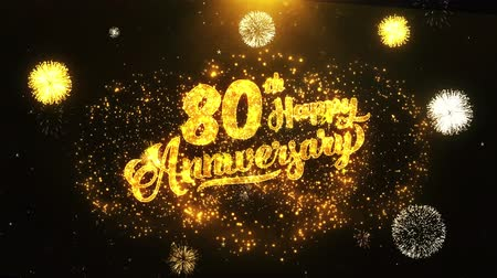 jubileu : 80th Happy Anniversary Text Greeting and Wishes card Made from Glitter Particles From Golden Firework display on Black Night Motion Background. for celebration, party, greeting card, invitation card. Vídeos