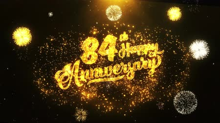 jubileu : 84th Happy Anniversary Text Greeting and Wishes card Made from Glitter Particles From Golden Firework display on Black Night Motion Background. for celebration, party, greeting card, invitation card.