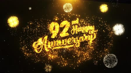 jubileu : 92nd Happy Anniversary Text Greeting and Wishes card Made from Glitter Particles From Golden Firework display on Black Night Motion Background. for celebration, party, greeting card, invitation card.