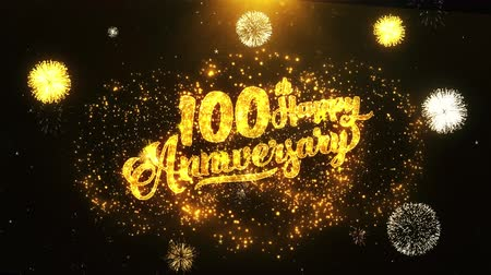 odznak : 100th Happy Anniversary Text Greeting and Wishes card Made from Glitter Particles From Golden Firework display on Black Night Motion Background. for celebration, party, greeting card, invitation card.