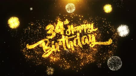 jubileu : 34th Happy Birthday Text Greeting and Wishes card Made from Glitter Particles From Golden Firework display on Black Night Motion Background. for celebration, party, greeting card, invitation card. Stock Footage