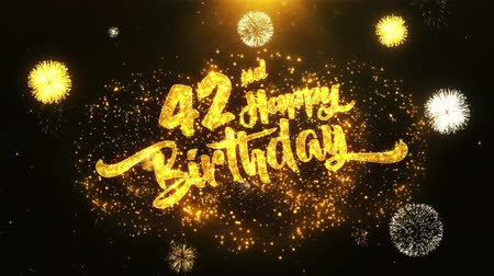 jubileu : 42nd Happy Birthday Text Greeting and Wishes card Made from Glitter Particles From Golden Firework display on Black Night Motion Background. for celebration, party, greeting card, invitation card.
