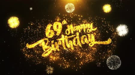 th : 69th Happy Birthday Text Greeting and Wishes card Made from Glitter Particles From Golden Firework display on Black Night Motion Background. for celebration, party, greeting card, invitation card.