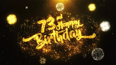 jubileu : 73rd Happy Birthday Text Greeting and Wishes card Made from Glitter Particles From Golden Firework display on Black Night Motion Background. for celebration, party, greeting card, invitation card.