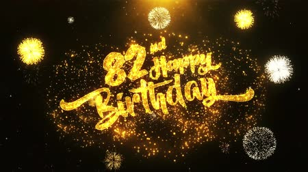 jubileu : 82nd Happy Birthday Text Greeting and Wishes card Made from Glitter Particles From Golden Firework display on Black Night Motion Background. for celebration, party, greeting card, invitation card.