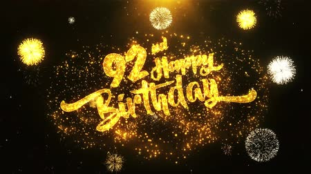 jubileu : 92nd Happy Birthday Text Greeting and Wishes card Made from Glitter Particles From Golden Firework display on Black Night Motion Background. for celebration, party, greeting card, invitation card.