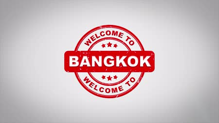 rubber stamp : Welcome to BANGKOK Signed Stamping Text Wooden Stamp Animation. Red Ink on Clean White Paper Surface Background with Green matte Background Included.