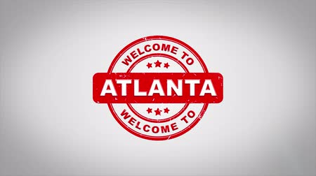 applying : Welcome to ATLANTA Signed Stamping Text Wooden Stamp Animation. Red Ink on Clean White Paper Surface Background with Green matte Background Included. Stock Footage