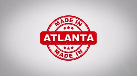 papírnictví : Made In ATLANTA Signed Stamping Text Wooden Stamp Animation. Red Ink on Clean White Paper Surface Background with Green matte Background Included.