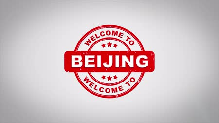 rubber stamp : Welcome to BEIJING Signed Stamping Text Wooden Stamp Animation. Red Ink on Clean White Paper Surface Background with Green matte Background Included. Stock Footage