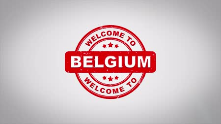 applying : Welcome to BELGIUM Signed Stamping Text Wooden Stamp Animation. Red Ink on Clean White Paper Surface Background with Green matte Background Included.