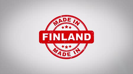 fabricated : Made In FINLAND Signed Stamping Text Wooden Stamp Animation. Red Ink on Clean White Paper Surface Background with Green matte Background Included. Stock Footage
