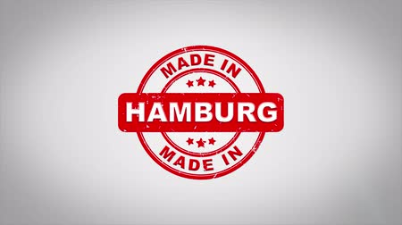 papírnictví : Made In HAMBURG Signed Stamping Text Wooden Stamp Animation. Red Ink on Clean White Paper Surface Background with Green matte Background Included. Dostupné videozáznamy