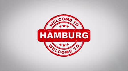 garancia : Welcome to HAMBURG Signed Stamping Text Wooden Stamp Animation. Red Ink on Clean White Paper Surface Background with Green matte Background Included.