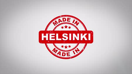 papírnictví : Made In HELSINKI Signed Stamping Text Wooden Stamp Animation. Red Ink on Clean White Paper Surface Background with Green matte Background Included.