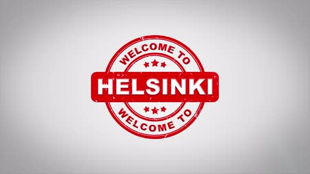 rubber stamp : Welcome to HELSINKI Signed Stamping Text Wooden Stamp Animation. Red Ink on Clean White Paper Surface Background with Green matte Background Included. Stock Footage