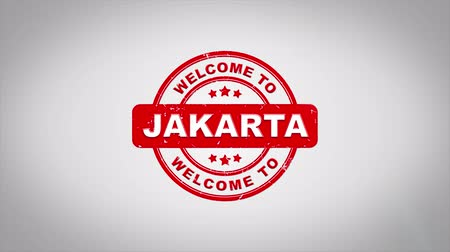 yapışkan : Welcome to JAKARTA Signed Stamping Text Wooden Stamp Animation. Red Ink on Clean White Paper Surface Background with Green matte Background Included. Stok Video