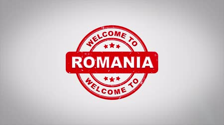 navrhnout : Welcome to ROMANIA Signed Stamping Text Wooden Stamp Animation. Red Ink on Clean White Paper Surface Background with Green matte Background Included.