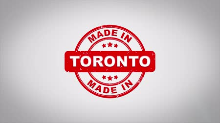 papírnictví : Made In TORONTO Signed Stamping Text Wooden Stamp Animation. Red Ink on Clean White Paper Surface Background with Green matte Background Included. Dostupné videozáznamy