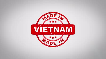 vietnamec : Made In VIETNAM Signed Stamping Text Wooden Stamp Animation. Red Ink on Clean White Paper Surface Background with Green matte Background Included. Dostupné videozáznamy