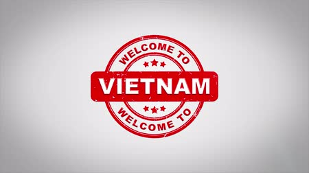 vietnamec : Welcome to VIETNAM Signed Stamping Text Wooden Stamp Animation. Red Ink on Clean White Paper Surface Background with Green matte Background Included. Dostupné videozáznamy
