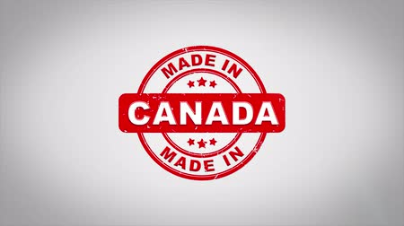 papírnictví : Made In CANADA Signed Stamping Text Wooden Stamp Animation. Red Ink on Clean White Paper Surface Background with Green matte Background Included.