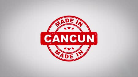 papírnictví : Made In CANCUN Signed Stamping Text Wooden Stamp Animation. Red Ink on Clean White Paper Surface Background with Green matte Background Included.