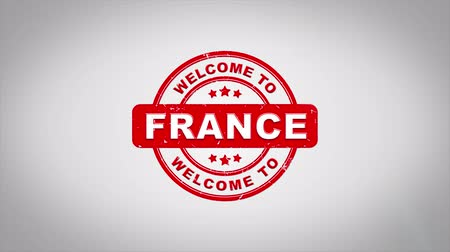 paříž : Welcome to FRANCE Signed Stamping Text Wooden Stamp Animation. Red Ink on Clean White Paper Surface Background with Green matte Background Included.