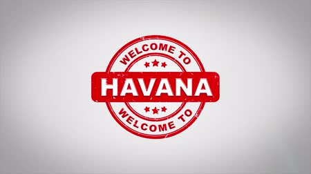 cigar : Welcome to HAVANA Signed Stamping Text Wooden Stamp Animation. Red Ink on Clean White Paper Surface Background with Green matte Background Included.
