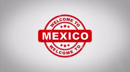 azték : Welcome to MEXICO Signed Stamping Text Wooden Stamp Animation. Red Ink on Clean White Paper Surface Background with Green matte Background Included.