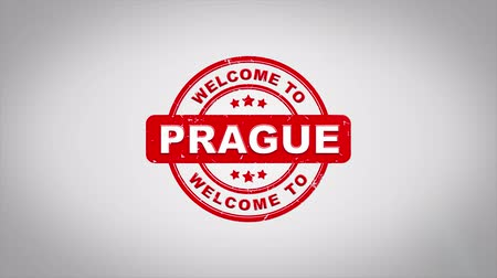 сделанный : Welcome to PRAGUE Signed Stamping Text Wooden Stamp Animation. Red Ink on Clean White Paper Surface Background with Green matte Background Included.