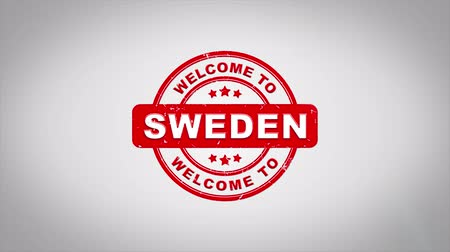 estocolmo : Welcome to SWEDEN Signed Stamping Text Wooden Stamp Animation. Red Ink on Clean White Paper Surface Background with Green matte Background Included.