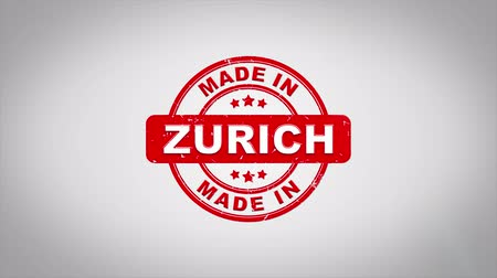 papírnictví : Made In ZURICH Signed Stamping Text Wooden Stamp Animation. Red Ink on Clean White Paper Surface Background with Green matte Background Included.